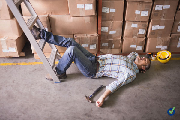 Side view of male worker lying on the floor in warehouse