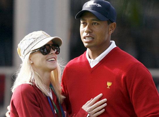 Golfista Tiger Woods y su esposa
